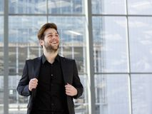 Trendy young man in black business suit Stock Image