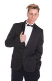 Trendy young man in black tuxedo Royalty Free Stock Photo