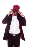 Trendy young man in a burgundy cap and bow tie Royalty Free Stock Photo
