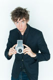 Trendy young man with camera Royalty Free Stock Photos
