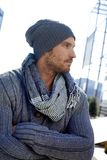 Trendy young man in hat and scarf Stock Photos