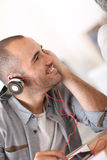 Trendy young man with headphones Royalty Free Stock Image