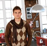 Trendy young man at home Stock Images
