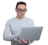 Trendy young man with laptop. isolated Stock Images