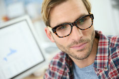 Trendy young man at office Stock Photos