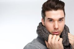 Trendy young man posing with gray wool scarf Royalty Free Stock Photo