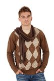 Trendy young man posing in scarf Royalty Free Stock Photos