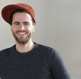Trendy young man smiling with hat Royalty Free Stock Image