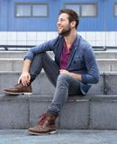 Trendy young man smiling outside Stock Images