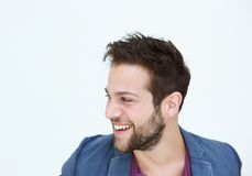 Trendy young man smiling on white background Royalty Free Stock Photo