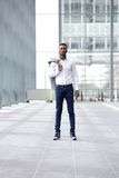 Trendy young man standing in building alone Royalty Free Stock Photos