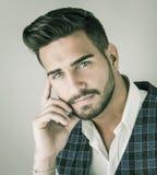 Trendy young man in studio shot wearing elegant vest Royalty Free Stock Images