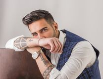 Trendy young man in studio shot wearing elegant vest Royalty Free Stock Image