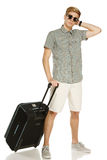 Trendy young man with suitcase Royalty Free Stock Photography
