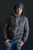 Trendy young man in winter clothes, studio shot Stock Images
