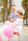 Trendy young mother with a baby daughter Royalty Free Stock Photo