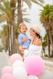 Trendy young mother with a baby daughter Stock Photo