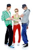 Trendy young people. Group of trendy teenagers dancing together. Isolated over white background Stock Photos