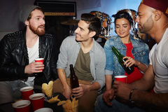 Trendy Young People Drinking Beer in Club Stock Images