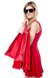 Trendy young shopaholic girl Royalty Free Stock Photos