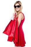 Trendy young shopaholic girl Royalty Free Stock Photos