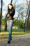 Trendy young woman in the country Stock Images
