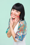 Woman in funky dress smiling Stock Image