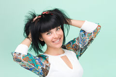 Woman in funky dress smiling Royalty Free Stock Photos