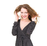 Woman in funky blue dress smiling Royalty Free Stock Photos
