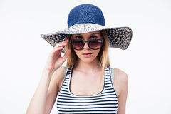 Trendy young woman in hat and sunglasses Royalty Free Stock Photo