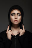 Trendy Young Woman in Hood over Black Background Royalty Free Stock Image