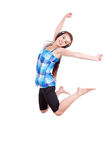 Trendy young woman jumping with joy Stock Image