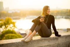 Trendy young woman listening music from smartphone outdoor Royalty Free Stock Photo