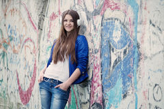 Trendy young woman listening to music Royalty Free Stock Photo
