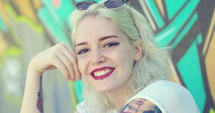Trendy young woman with a pierced lip stock video