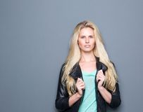 Trendy young woman posing with black leather Royalty Free Stock Photo