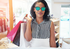 Trendy young woman shopping in sunglasses Royalty Free Stock Photography