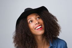 Trendy young woman smiling with hat Royalty Free Stock Photos