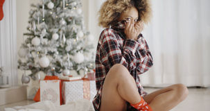Trendy young woman waiting for Christmas Royalty Free Stock Images