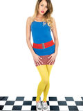 Trendy Young Woman Wearing Mini Skirt and Blue Tee Shirt with Yellow Tights Stock Photos