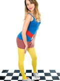 Trendy Young Woman Wearing Mini Skirt and Blue Tee Shirt with Yellow Tights Stock Photo