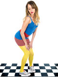 Trendy Young Woman Wearing Mini Skirt and Blue Tee Shirt with Yellow Tights Stock Image