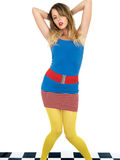 Trendy Young Woman Wearing Mini Skirt and Blue Tee Shirt with Yellow Tights Royalty Free Stock Images