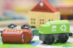 Trenes de madera del juguete dos en el camino con el hospital en selecti del contexto Fotos de archivo