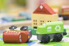 Trenes de madera del juguete dos en el camino con el hospital en selecti del contexto Imagen de archivo libre de regalías