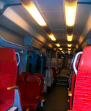 trenes modernos del salón rojo elegante del transporte Fotos de archivo libres de regalías