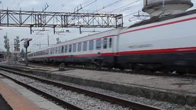 Trenitalia Frecciabianca Passenger Train is Passing from a Station. I shoot this in Pisa, Italy stock video