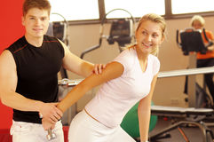 The trenning in fitness centre Stock Photography