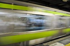 Treno commovente Immagine Stock