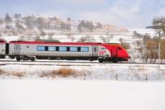 Treno del Virgin nella neve Immagine Stock